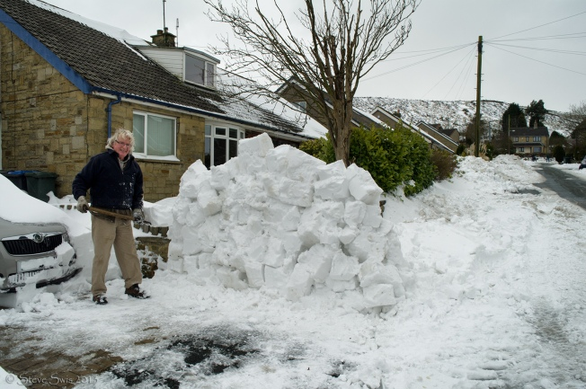 "Shifting snow, army-style. ""Had to do this in the army. Had to be a lot neater then, too."""